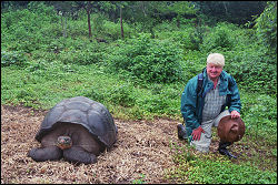 Stanley with giant tortoise, Galapagos Islands